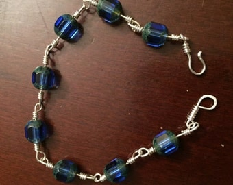 Twisted sterling silver wire blue glass bead bracelet - 7""
