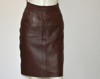 VINTAGE pencil skirt,leather , small size, brand new