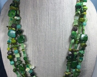 Green  multiple strand necklace with lamp work beads bali silver and stone