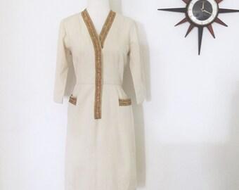 Vintage 1960s Madmen style woolen brocade trim well tailored dress