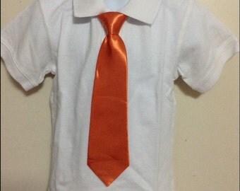 Orange elastic band necktie for children.