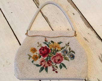 This is a beauty! Vintage white beaded needlepoint purse.