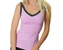 Baby pink figure hugging V-neck gym singlet top with grey trim for workouts or casual wear