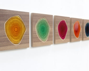 Five wall sculptures in carved wood and colorful resin