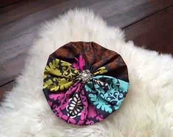 Yo-yo fabric flower hair clip