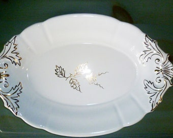 Oval plate painted gold