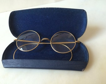 Vintage round spectacles with slim case