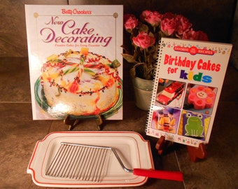 Retro Bakelite Cake Server and  Cake Making /Decorating Cookbooks.