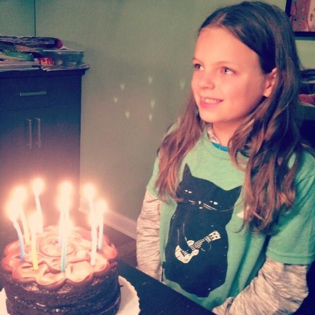Birthday girl in our Ukulele Cat tee for kids.