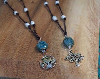 Leather Knotted Fresh Water Rice Pearl Necklace with Blue Speckled Stone Cabochon and Silver Tree or Bird Charm