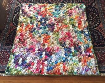 Handquilted raindrop hexagon lap quilt