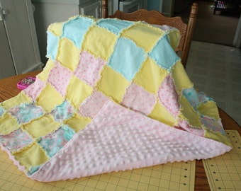 Beautiful homemade baby quilts... soft and cuddly.. you pick the colors. blues, pinks, greens, yellows..etc...