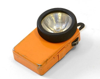Vintage French orange flash light with a sturdy belt loop.