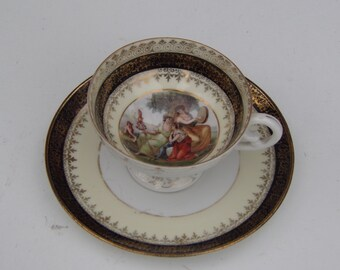 Antique Royal Vienna Porcelain Cup & Saucer 18thC Hand Painted Decor and gold accent Rare Collectible
