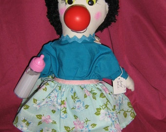 Clown doll in handmade clothes
