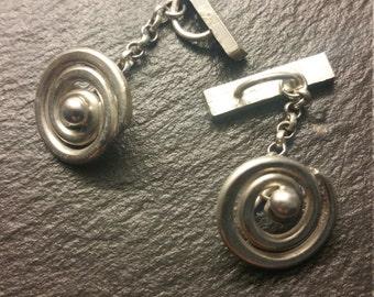 Hand forged sterling silver spiral cufflinks.