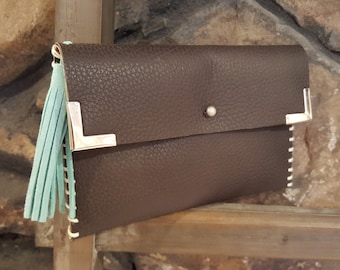 Brown leather clutch with turquoise tassel