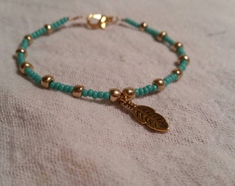 Turquoise and Gold Beaded Bracelet With Feather Charm