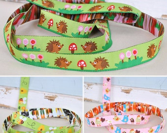 Web belts 16 mm wide with various motifs such as hedgehogs, birds and bees