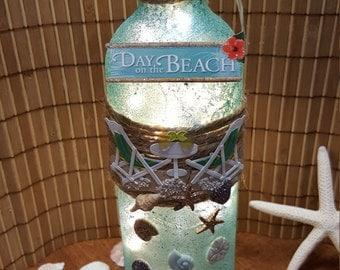 Beach lovers lighted wine bottle