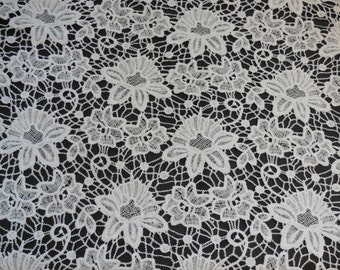 Ivory bridal wedding floral lace fabric / vintage cotton lace fabric is for sale. Sold by Per 0.5 Meter