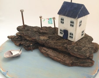 Driftwood seaside cottage scene