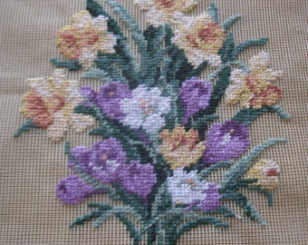 """Vintage pre-worked needlepoint. 18""""x18"""" Daffodils and crocus, main colors – purples, yellows, greens."""