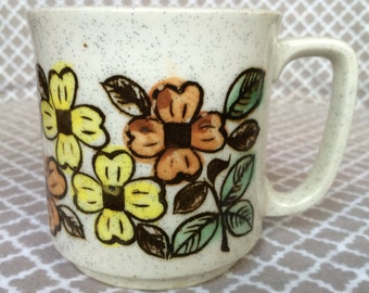 Vintage stoneware speckled coffee mug - yellow and orange flowers - made in japan