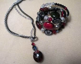 Red , Black and Silver necklace and memory wire bracelet.