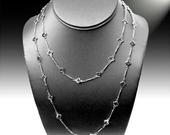 Long  chain cross necklace.