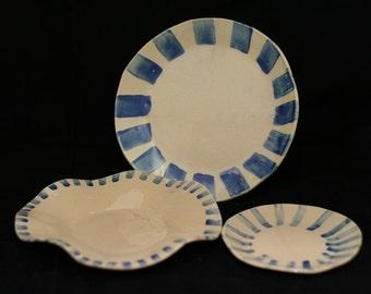Trio of decorated ceramic dishes