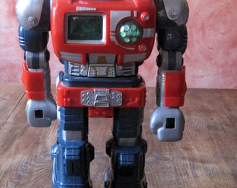 Super robot interactive old toy works has batteries advance, speaks, turns the body, makes noises and lights model (1996)