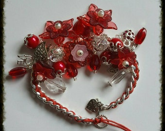 Bright and beautiful floral charm bracelet in vibrant reds and pinks red/bling/charm/summery/silver plated 20cm