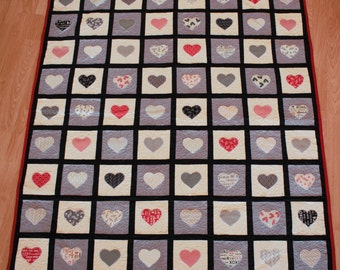 Contemporary red, white and black heart quilt