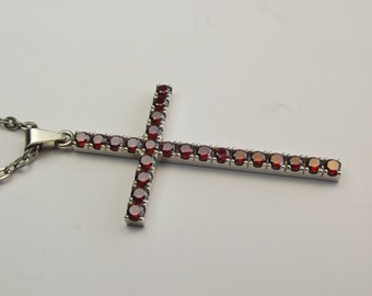 cross with 3mm red AAAczs. hand  paved into sterling silver