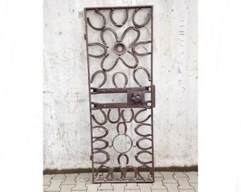 Old iron gate/door Horseshoe shabby industrial