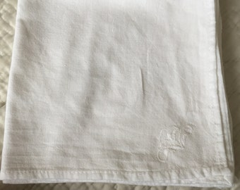 4 vintage white napkins.