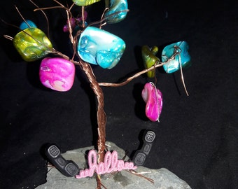 copper tree with colorful stones and phone