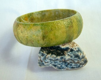 Unique, funky and fun, green-gold wooden decoupage bangle racelet.