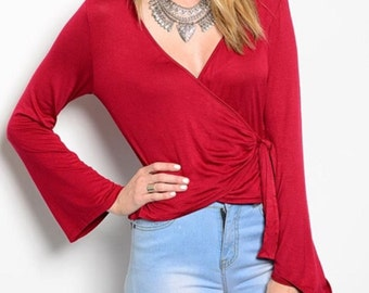 Wrap Top A Deep V Neck Line  Bell Sleeves