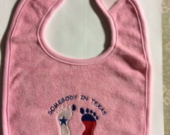 Somebody in Texas loves me pink baby bib