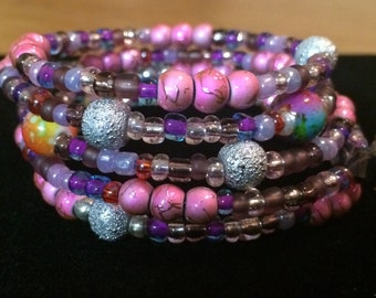 Pink with silver and variety of colors bracelet