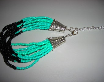 12 strand black and teal baded bracelet with lobster claw clasp