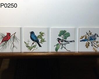 4 vintage tiles of birds