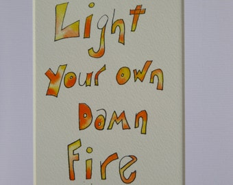 """Light the fire in you, with this watercolor quote, tie dye effect in yellow and orange """"Light your own damn fire"""" - good words to live by."""