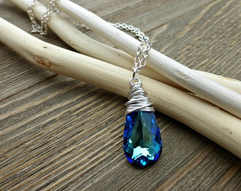 Bermuda Blue Swarovski Crystal pendant, silver metal wire wrapping and silver chain necklace.