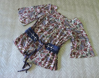 Tween girls retro paisley print top with hand beaded contrasting blue belt featuring vintage beads.