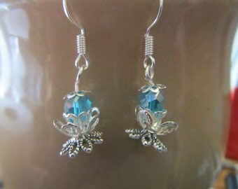 Lotus earrings with blue bead