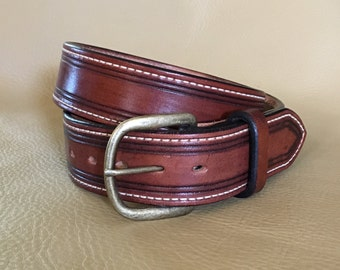"""Leather belt mahogany  in color stitched with a borderline 1 1/2"""" wide size 32 1/2"""" hand rubbed and hot waxed edges"""