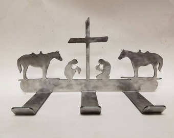 Cowboy and Cowgirl Praying at the Cross with Horses Wall Hanger. Wall Hanger to hold your stirrups, lasso, and other Riding Gear!